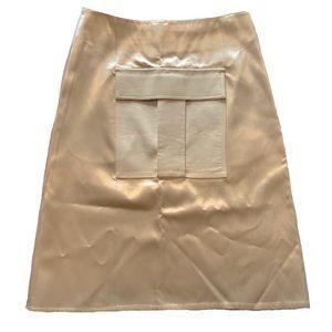 CÉLINE satin front pocket skirt in cream